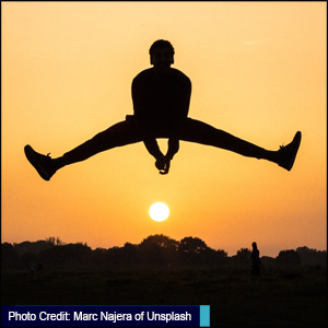 Picture of man jumping - Photo credit Marc Najera of Unsplash - link to mental well being resources