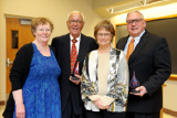 Cathie and L. Gene Lemon with Dr. John Shustitzky receiving awards from Wendy Heller