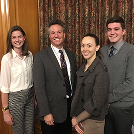 Benjamin Hankin, second from left, with students after an investiture ceremony honoring him as the Fred and Ruby Kanfer Professor of Psychology.