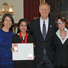 "Shivaliben ""Shivali"" Bhargavkumar Patel, center, poses alongside Illinois Gov. Bruce Rauner as she receives the Lincoln Academy Student Laureate Award. (Photo courtesy of the Office of the Governor.)"