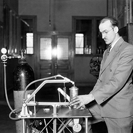 Charles Getz demonstrates his instant whip cream machine at Illinois in the early 1930s.