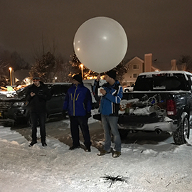 Students from the University of Illinois prepare to launch a radiosonde to measure atmospheric conditions during the SNOWIE project. (Photo by Bob Rauber.)