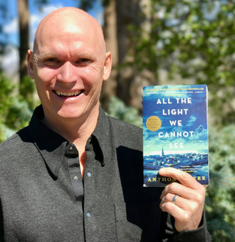 """Author Anthony Doerr with his 2014 Pulitzer Prize-winning novel, """"All the Light We Cannot See."""""""