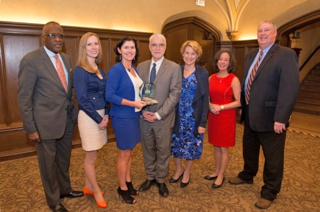 L-R: Chancellor Robert Jones, Chicago Illini Club President Sarah Ayers, Illini of the Year Award recipient Rebecca Darr, President Timothy Killeen, First Lady of the University Roberta Johnson Killeen, Trustee Jill Smart, and UIAA Interim President Doug Beckmann