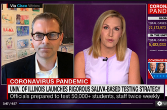 Still shot from a CNN television interview of chemistry professor Martin Burke, on left side of television screen, and CNN interviewer on the right side of the screen