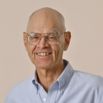 Head shot of Peter Beak in a light blue collared shirt on a white background