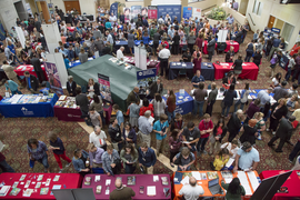 High school students visit with college representatives at the inaugural Salute to Illinois Scholars college fair in Mount Vernon on Tuesday, September 12, 2017.