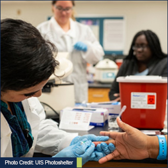 Photo credit: UIS photoshelter - Picture of a person getting blood drawn to check for blood type and cholesterol levels.