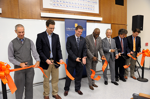 Chancellor Robert Jones, center, and Feng Sheng Hu, Harry E. Preble Dean of the College of LAS, third from right, and others at Illinois celebrated the renovated Chem Annex with a ribbon-cutting in early October.