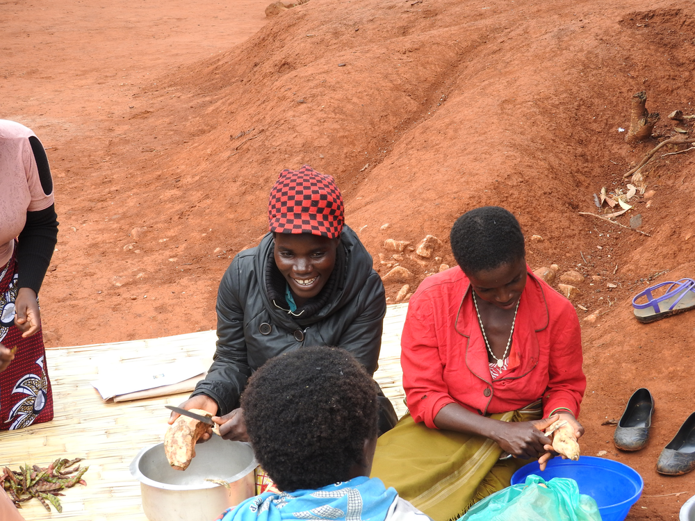Women cook sweet potatoes for a nutritious-cooking demonstration day.