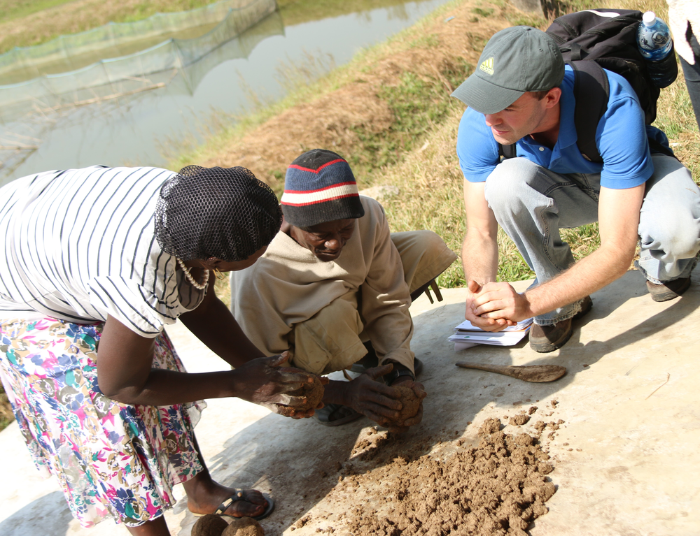 Aunty Gladis demonstrates how to make fish feed in Aquaculture Fish Pond in Tonkollilli district.