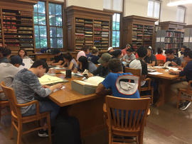 Picture of Architecture 101 students studying sketchbooks