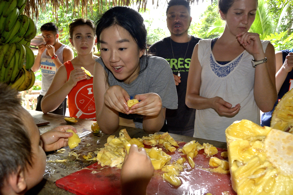 a student eating jackfruit in Costa Rica