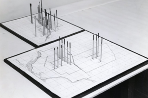 physical model in which vertical rods extending from a map show the change of groundwater levels in the Joliet, Illinois, area