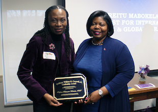 photo of vice provost mabokela with danita brown young as she receives the creswell award