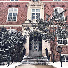Exterior of Gregory Hall with snow