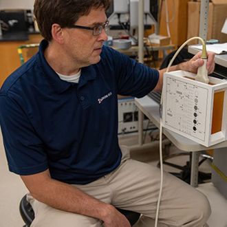 Michael Oelze works with an ultrasound machine.