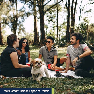 People sitting with friends - Photo credit: Helena Lopez of Pexels