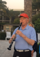 Ron Archer playing the clarinet outside