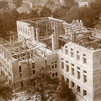 Altgeld Hall photo displays the construction effort as the building opened in 1897