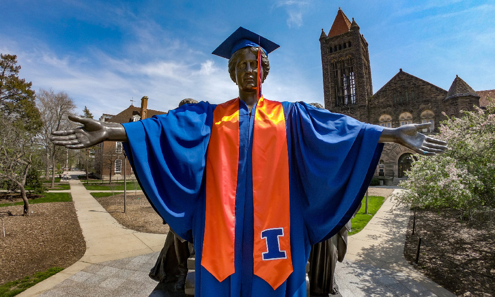 Alma Mater decked out for commencement in a cap and gown.