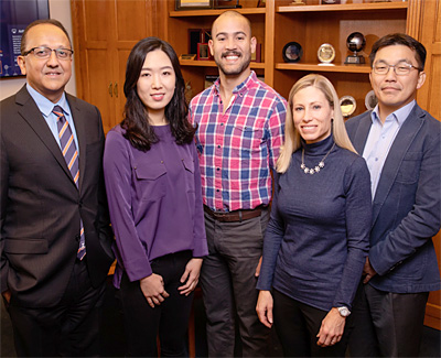 From left: College of Engineering Dean Rashid Bashir, graduate students Clare Ko and Gelson Pagan-Diaz, and professors Marni Boppart and Hyunjoon Kong. Photo by L. Brian Stauffer.