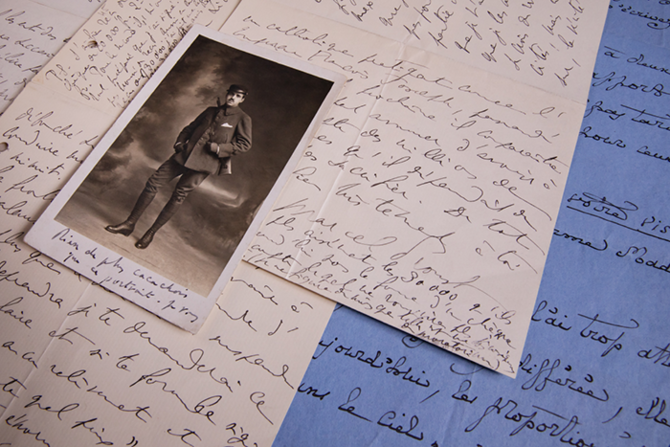 A sample of some of the more than 1,200 Proust letters at Illinois' Rare Book and Manuscript Library. The man in the photograph is the composer Reynaldo Hahn, who wrote a postcard to Proust on the back. The letter on blue paper was written to Proust by aristocrat and poet Robert de Montesquiou. Proust wrote the other letters in the photograph. (Photo by L. Brian Stauffer.)