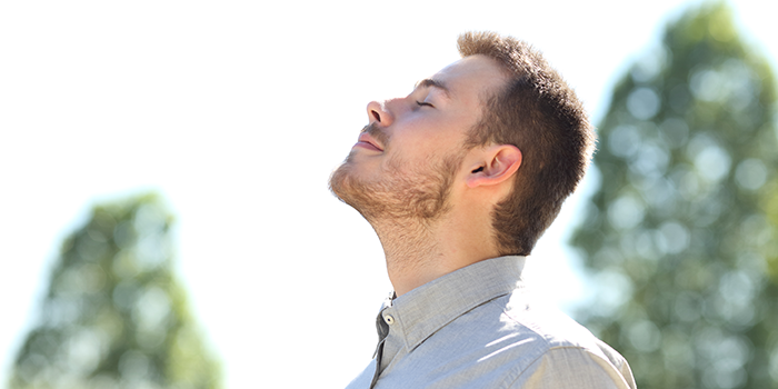 male student feeling mindful in the moment