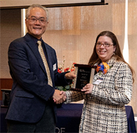 Sarah Challand (right) was presented with a College of LAS Staff Award by Dean Feng Sheng Hu on March 4, 2019 at the Alice Campbell Alumni Center.