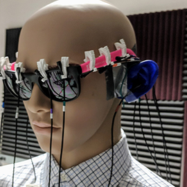 Microphones on a mannequin were used as a way to collect data during research.