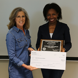 Marie-Pierre receiving the Academic Professional Award