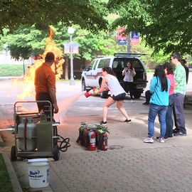 Fire extinguisher training at the Joint Safety Team's 3rd Annual Safety Week.