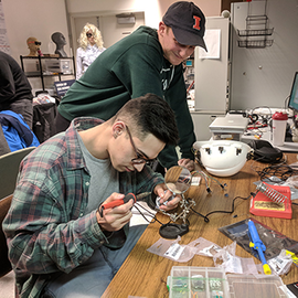 Students work on their prototypes.