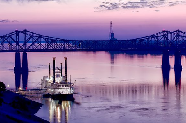 Mississippi river with boat and bridge