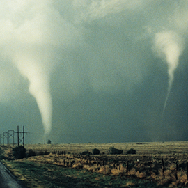 two tornados over a field