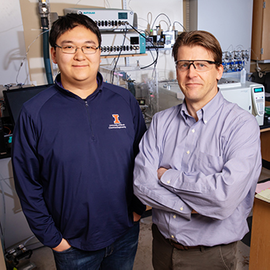 Chemical and biomolecular engineering professor and department chair Paul Kenis, right, and graduate student Shawn Lu.