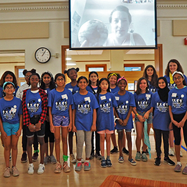Middle school girls pose for a photo with a scientist (who joined them via Skype) at a geoscience camp for girls organized by doctoral students in the School of Earth, Society, and Environment.