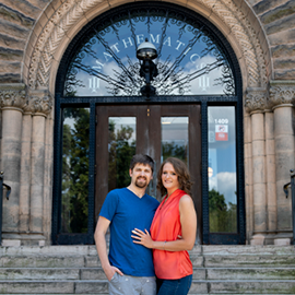 Nathan and Betsy Alderman pose by the north steps of Altgeld Hall, where Nathan proposed seven years ago.