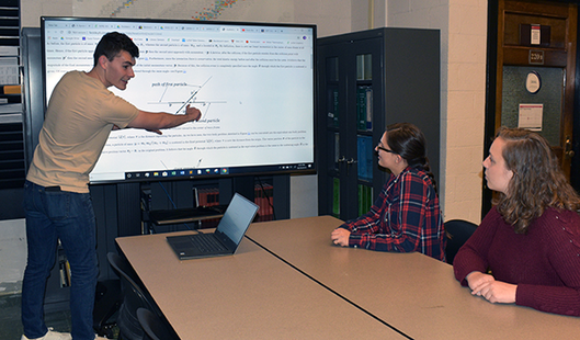 Students working with the new monitor