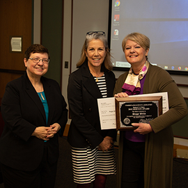 Peggy Wells receiving her award from committee chair Carolyn Beck and CSL Director Klara Nahrstedt