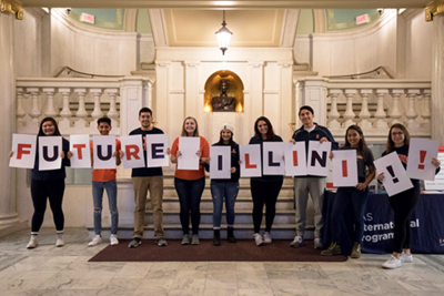 students holding signs to spell Future Illini!!