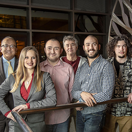 First author, Gelson Pagan-Diaz, second from right, joins his interdisciplinary team, from left, Dean Rashid Bashir, Karla Ramos-Cruz, Onur Aydin, Gabriel Popescu, and Mikhail Kandel, far right. Not pictured are Taher Saif and Richard Sam.