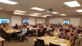 Participants in the Jr. Faculty Seminar Series wave to the camera