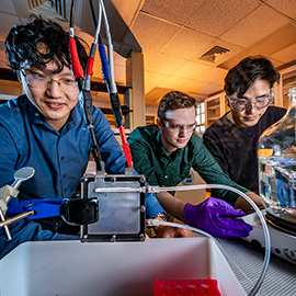 Professor Xiao Su, left, graduate student Stephen Cotty, center, and postdoctoral researcher Kwiyong Kim in the lab