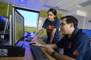 Nicolas Martin (foreground) works with student to visualize digital field data. Photo by L. Brian Stauffer