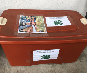 Orange box labeled for donation collection