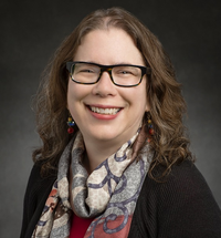 Head shot of Cathy Murphy, department head, on a gray background