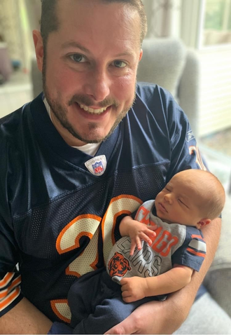 Portrait of a man holding a baby