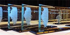 several sustainability award trophies in a line