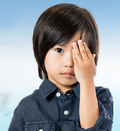 Child covering eye for test